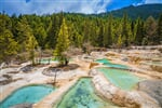 View of hot spring in Jiuzhaigou National Park, Huanglong, Sichuan, China, Asia._shutterstock_662433307