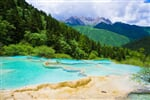 Turquoise mountain lake. Colorful pools formed by calcite deposits, especially in Huanglonggou _shutterstock_533843851