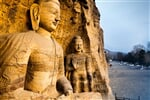 Stone carved Buddhas at Yungang Grottoes Datong, China._shutterstock_571675372