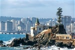 View of Wulff Castle with apartment buildings in the background in Vina del Mar, Chile_shutterstock_7088842571