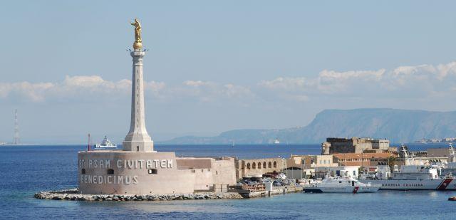 Madonnina del Porto statue and Coast Guard station in Port of Messina. The Mediterranean Sea, Island of Sicily, Italy, Southern Europe