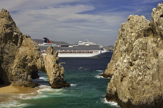 Splendor Cabo San Lucas Ship Behind Rocks