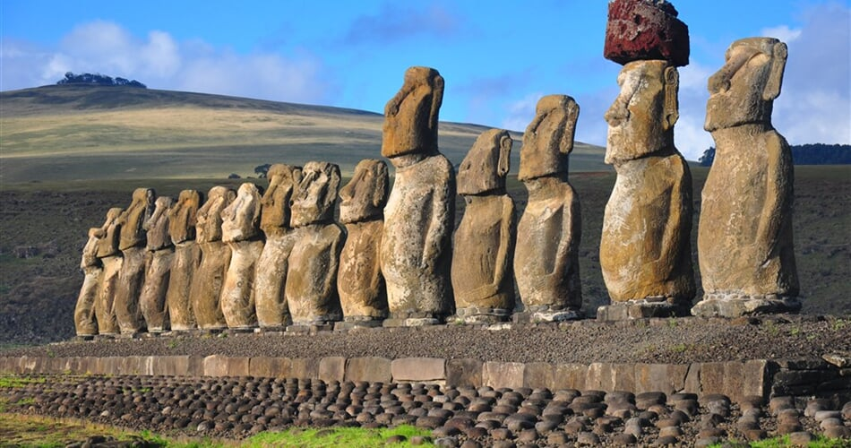 Group of 15 restored moai at Tongariki, Easter Island, in the afternoon sunshine_shutterstock_866725271
